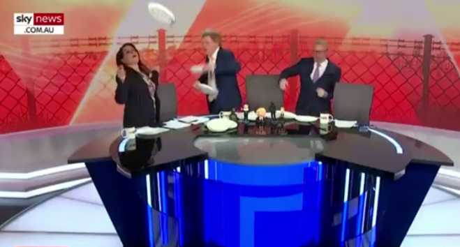 OPA!  Australian TV presenters celebrate Mitsotakis victory dancing and breaking plates