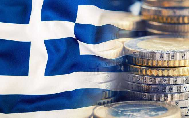 Bloomberg: Mountain of debt hinders Greek economy recovery