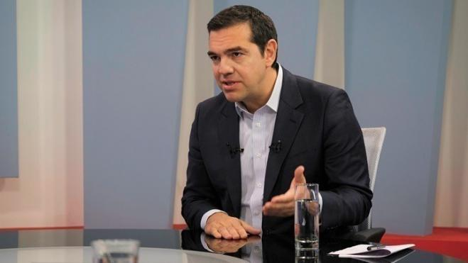 SYRIZA's Tsipras meets with Iranian Ambassador to Greece